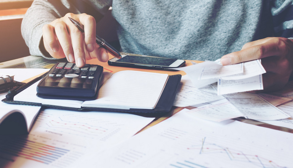 Man calculating energy bill from utility company rate increases